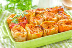 Stuffed peppers. In a pan on a wooden table Stock Photography
