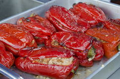 Stuffed Peppers. A tray of baked stuffed red bell peppers Stock Photo