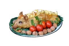 Stuffed pig dish. Isolated on white background stock image