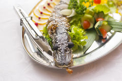 Stuffed pike decorated with vegetables and the greens. Very beautiful restaurant dish Royalty Free Stock Image
