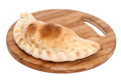 Stuffed pirogue served on the wooden board Royalty Free Stock Photography