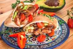 Stuffed pita bread with fried chicken with onions, lettuce leave Royalty Free Stock Photo