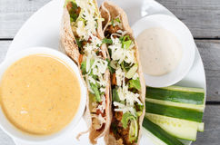 Stuffed pita with meat, cheese, vegetables Stock Photo