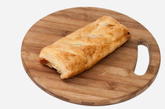 Stuffed pizza puff pastry on the wooden board Stock Photo