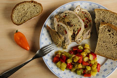 Stuffed pork with vegetables and bread. Stuffed pork with healthly vegetables and bread Stock Photos