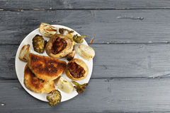 Stuffed potatoes and cutlets above view Stock Photography