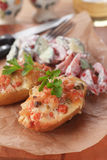 Stuffed potatoes. Roasted potatoes stuffed with vegetables, healthy vegetarian meal Royalty Free Stock Image