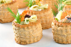 Stuffed puff pastry shells Stock Photos