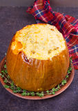 Stuffed pumpkin with meat, rice, mushrooms,  pepper and thyme Royalty Free Stock Photos