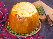 Stuffed pumpkin with meat, rice, mushrooms,  pepper and thyme Royalty Free Stock Images