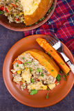 Stuffed pumpkin with meat, rice, mushrooms,  pepper and thyme Stock Photos