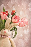 Stuffed rabbit with tulips for Easter Stock Image