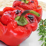 Stuffed red bell peppers. Closeup of some appetizing stuffed red bell peppers Stock Image