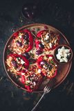 Stuffed Red Pepper with Millet, Chorizo, Feta Cheese and Greek Olive. On dark background royalty free stock images