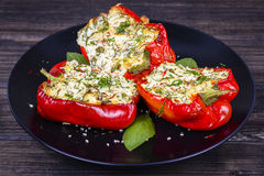Stuffed red peppers in black plate Royalty Free Stock Photography