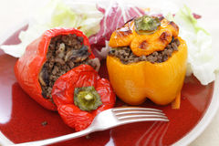 Stuffed red and yellow peppers Stock Photos
