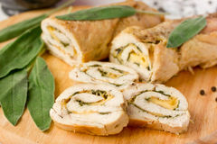Stuffed roll of chicken with cheese and sage Stock Photo