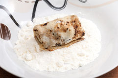 Stuffed rolled pancake in the flour ready for paning Royalty Free Stock Photos