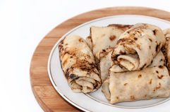 Stuffed rolled pancakes with sour cream fried bacon Stock Images