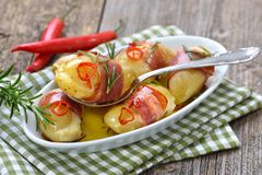 Stuffed rosemary potatoes Stock Image