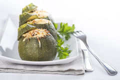 Stuffed round courgettes with grated cheese Royalty Free Stock Image