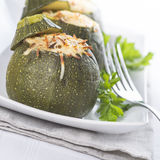 Stuffed round courgettes with grated cheese Stock Photography