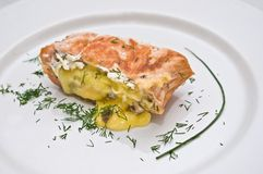 Stuffed salmon. Baked salmon stuffed with blue cheese royalty free stock photo