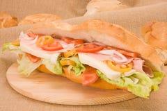 Stuffed sandwich. Sandwich stuffed with mozzarella tomato salad ham Stock Images