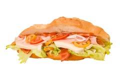 Stuffed sandwich. Sandwich stuffed with mozzarella tomato salad ham Royalty Free Stock Images