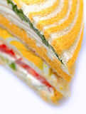 Stuffed sandwich isolated. Closeup stuffed sandwich isolated with fresh ingredients Royalty Free Stock Photos