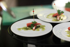 Stuffed sausages canape with pesto sauce Stock Photography