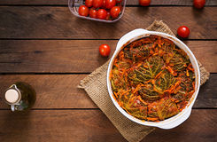 Stuffed savoy cabbage rolls in tomato sauce Royalty Free Stock Images