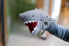 Stuffed shark toy on the hand royalty free stock photography