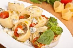 Stuffed shell pasta with tomato sauce Stock Photos
