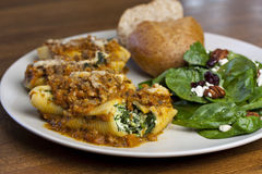 Stuffed Shells and Salad Stock Images