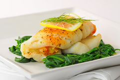 Stuffed Sole. Sole stuffed with crab on a bed of spinach Stock Images