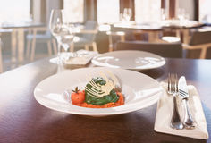 Stuffed spinach leaves with tomato sauce and cabbage, toned Stock Image
