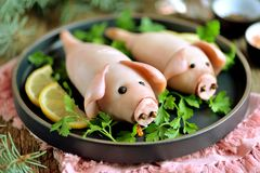 Stuffed squids in the form of cute pigs - a symbol of the year 2019. stock photo