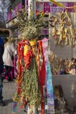 Stuffed straw sold at a street fair dressed in colorful clothes, scarf and skirt and decorated with ribbons royalty free stock images