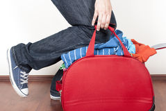 Stuffed suitcases Stock Photos