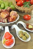 Stuffed Tapas with fruits and bacon Royalty Free Stock Photography