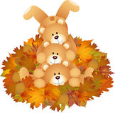Stuffed teddy bears on set fall leaves Stock Photography