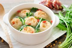 Stuffed Tofu Ball. Tofu and ground beef balls stuffed with sausage and shepherd's-purse leaves, which are simmered in savory soup Stock Image