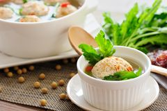Stuffed Tofu Ball. Tofu and ground beef balls stuffed with sausage and shepherd's-purse leaves, which are simmered in savory soup Royalty Free Stock Images