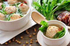 Stuffed Tofu Ball. Tofu and ground beef balls stuffed with sausage and shepherd's-purse leaves, which are simmered in savory soup Royalty Free Stock Photography