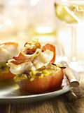Stuffed tomato with bacon and molten cheese Stock Image