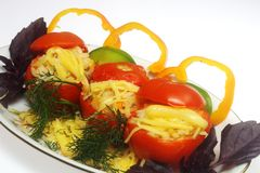 Stuffed tomato on the plate Royalty Free Stock Photography