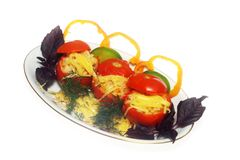 Stuffed tomato on the plate stock image