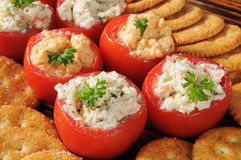 Stuffed tomatoes and crackers Stock Image
