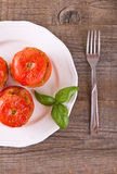 Stuffed tomatoes on a white plate. Royalty Free Stock Images